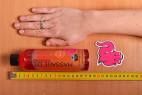 Shiatsu hrejivý masážny olej - meriame dĺžku fľaštičky s olejom